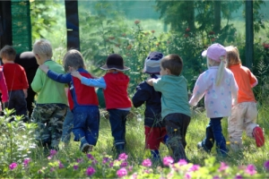 group of kids hiking outdoors in the autumn forest